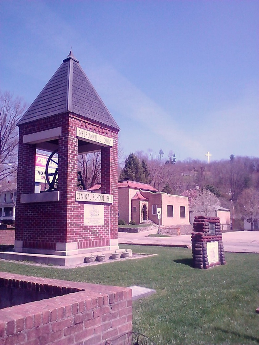 The Central School Bell in Nelsonville. In the background, you can see the Nelsonville Cross.