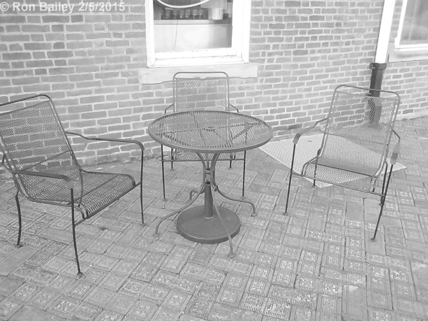 A table and a couple chairs outside a coffee shop in Nelsonville.