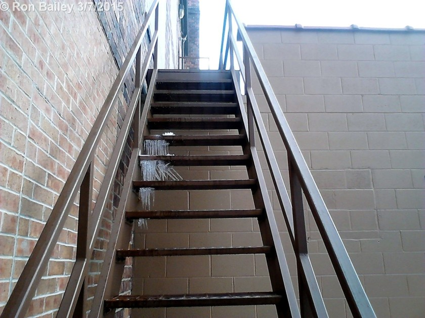 A photo of some stairs I took yesterday. Check the funky icicles underneath!