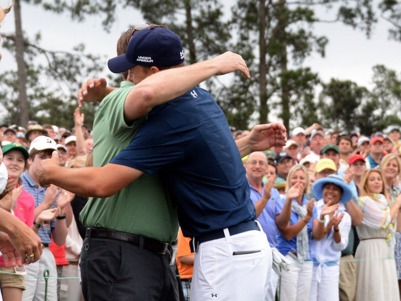 Jordan Spieth of the US hugs his father Shawn as he celebrates winning the 79th Masters Golf Tournament at Augusta National Golf Club on April 12, 2015, in Augusta, Georgia. (JIM WATSON/AFP/Getty Images)