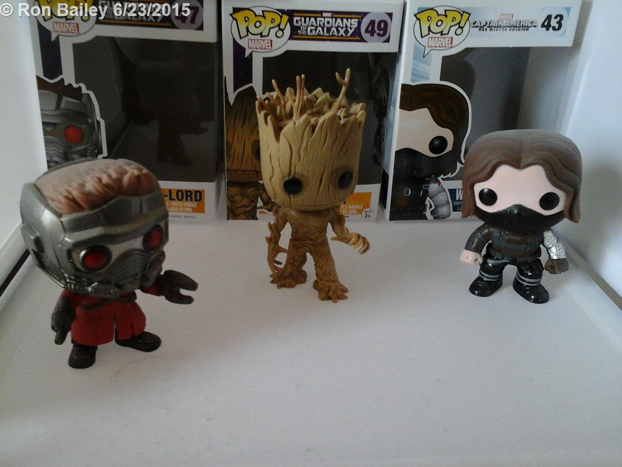 I acquired Star-Lora and Groot from Disney Movie Rewards, and Winter Soldier came for the Marvel Shop site.