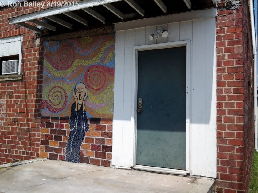 The door itself isn't much, but check out the artwork next to it!